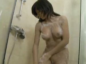 Shower Girl Sits On A Dildo And Fills Her Vagina